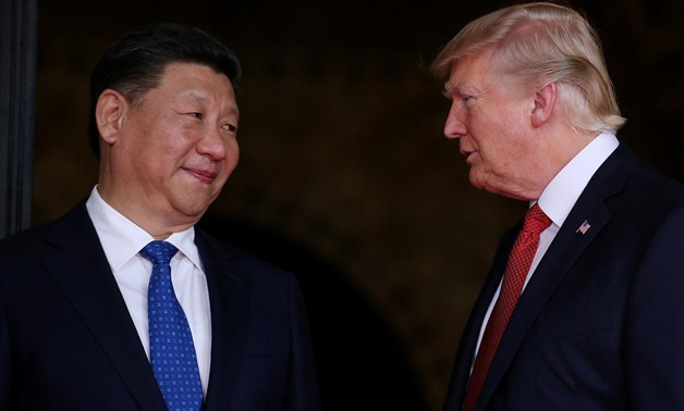 FILE PHOTO: U.S. President Donald Trump welcomes Chinese President Xi Jinping at Mar-a-Lago state in Palm Beach, Florida, U.S., April 6, 2017.