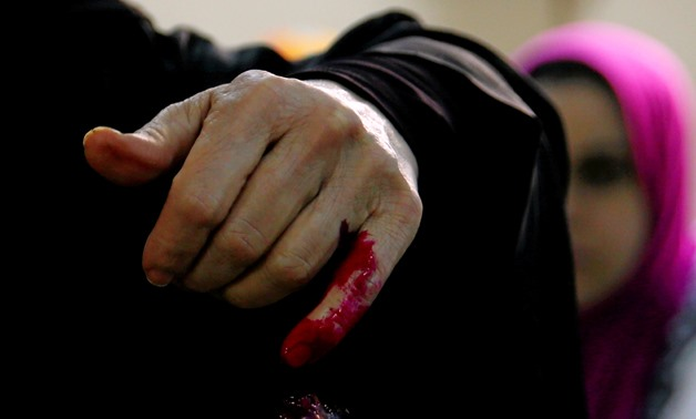 An Egyptian woman has her finger stained with ink after casting her vote during the first day of the presidential election at a polling station in Cairo, Egypt, March 26, 2018. REUTERS/Amr Abdallah Dalsh