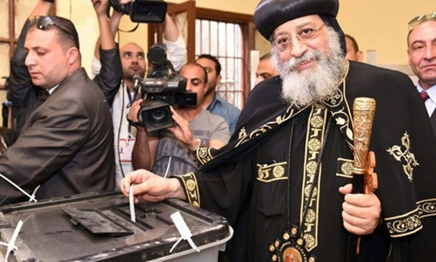 Pope Tawadros II casts his vote in a close school to the Cathedral of Abbasiya- Press photo