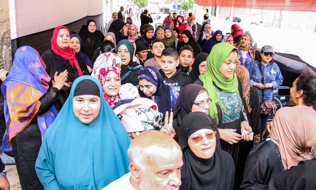 Egyptians waiting outside a polling station in Cairo's al-Sayyeda Zeinab neighborhood to cast their votes in the presidential election- Egypt Today /Ashraf Fawzy