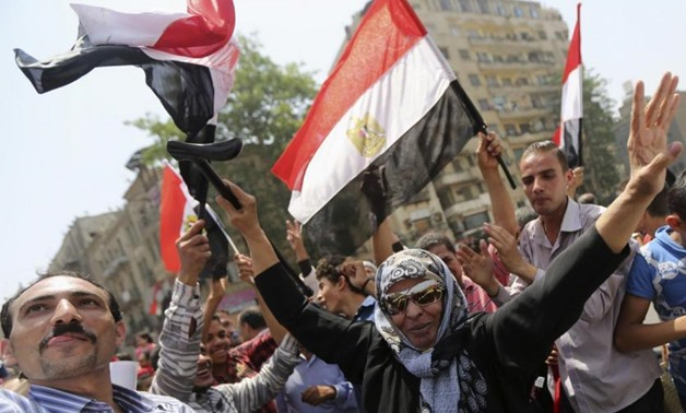 A woman celebrates Abdel Fattah al-Sisi's victory in the Egyptian presidential elections in Tharir Square, in Cairo May 29, 2014. REUTERS/Amr Abdallah Dalsh
