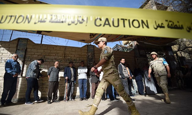 Armed forces securing polling stations while queues of voters lining up waiting to cast their vote in the 2018 presidential election - AFP/Mohamed El-Shahid