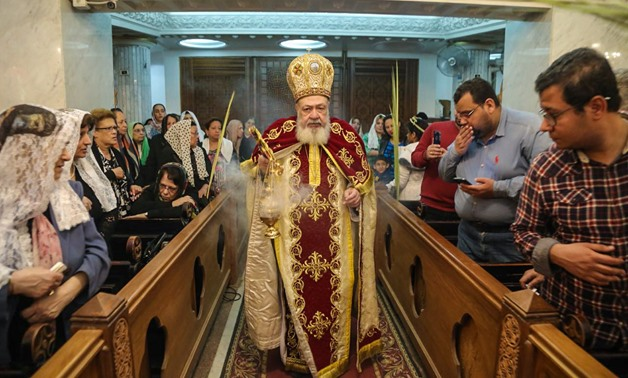 Bishop of Virgin Mary Coptic Orthodox Church attends a mass on Sunday to celebrate Palm Sunday, 1 April 2018 – Egypttoday/Mahmoud elHosry