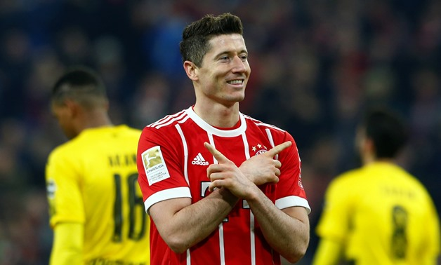 Soccer Football - Bundesliga - Bayern Munich vs Borussia Dortmund - Allianz Arena, Munich, Germany - March 31, 2018 Bayern Munich's Robert Lewandowski celebrates scoring their sixth goal to complete his hat-trick REUTERS/Michaela Rehle