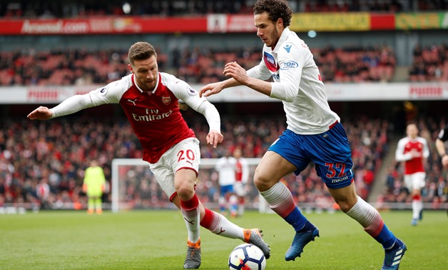 Soccer Football - Premier League - Arsenal vs Stoke City - Emirates Stadium, London, Britain - April 1, 2018 Stoke City's Ramadan Sobhi in action with Arsenal's Shkodran Mustafi Action Images via Reuters/John Sibley