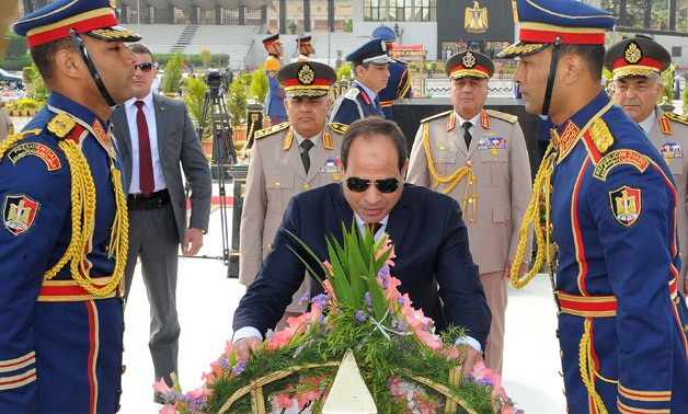 File- President Sisi lays wreath of roses on Unknown Soldier Memorial - press photo