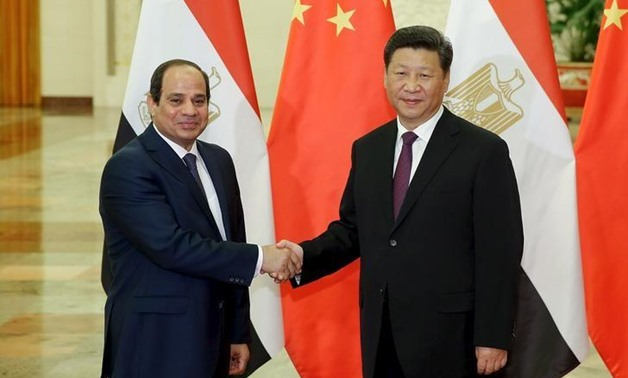 Chinese President Xi Jinping (R) shakes hands with Egyptian President Abdel Fattah Al-Sisi at The Great Hall Of The People on September 2, 2015 in Beijing.