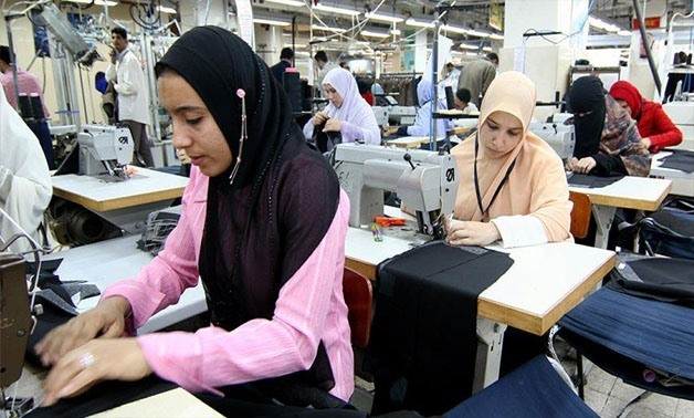Women work in a factory that makes men's suits in 10th of Ramadan City, Egypt, Feb. 22, 2006 - Reuters