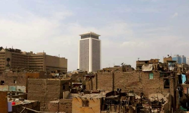 FILE – Part of slums in Maspero Triangle, Ministry of Foreign Affairs can be seen in the background