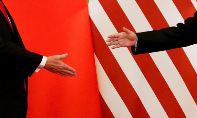 U.S. President Donald Trump and China's President Xi Jinping shake hands after making joint statements at the Great Hall of the People in Beijing, China, November 9, 2017. REUTERS/Damir Sagolj/File Photo