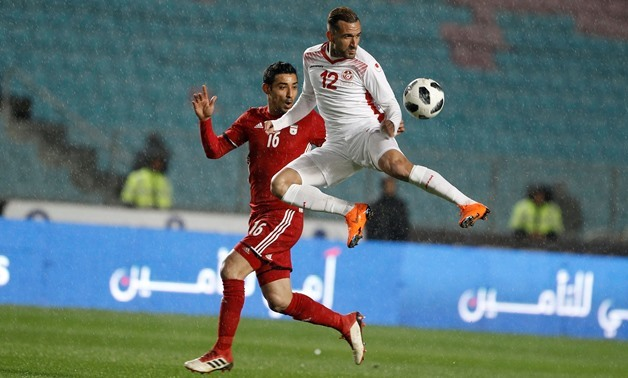 Soccer - International Friendly - Tunisia v Iran - Rades Olympic Stadium, Rades, Tunisia - March 23, 2018. Tunisia's Maaloul Ali in action with Iran's Reza Ghoochannejhad. REUTERS/Zoubeir Souissi