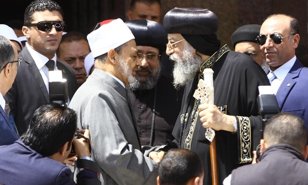 Grand Imam of Azhar Ahmed el-Tayyib shakes hands with Pope Tawadros outside the cathedral after Easter celebrations on April 8, 2018 - Photo by Mahmoud Fakhry/Egypt Today