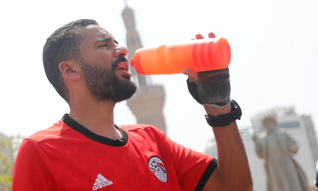 Egyptian cyclist Mohamed Nofal drinks water in front of Omar Makram mosque before his journey to Russia for the 2018 Fifa World Cup after Egypt qualified for the first time in 28 years, in Cairo, Egypt, April 7, 2018. REUTERS/Amr Abdallah Dalsh