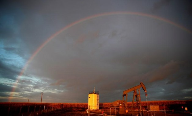 A rainbow is seen over a pumpjack during sunset outside Scheibenhard, near Strasbourg, France, October 6, 2017. REUTERS/Christian Hartmann