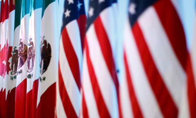 Flags of Canada, Mexico and the U.S. are seen before a joint news conference on the closing of the seventh round of NAFTA talks in Mexico City, Mexico March 5, 2018. REUTERS/Edgard Garrido
