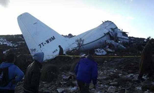 A crashed military plane is pictured in Oum El Bouaghi province, about 500km from the capital Algiers - Reuters