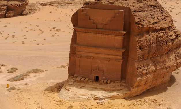 A picture taken on April 1, 2018 shows an aerial view of the Qasr al-Farid tomb (The Lonely Castle) carved into rose-coloured sandstone in Madain Saleh, a UNESCO World Heritage site, near Saudi Arabia's northwestern town of al-Ula.The tombs, some containi
