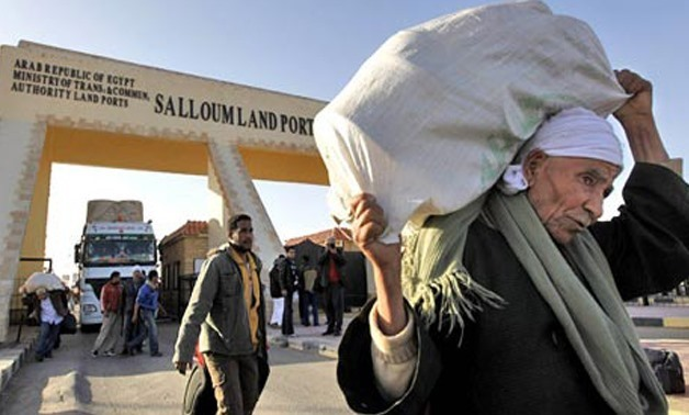 File Photo: Egyptians entering from Libya, Salloum border, August 2011 (Photo: Reuters)