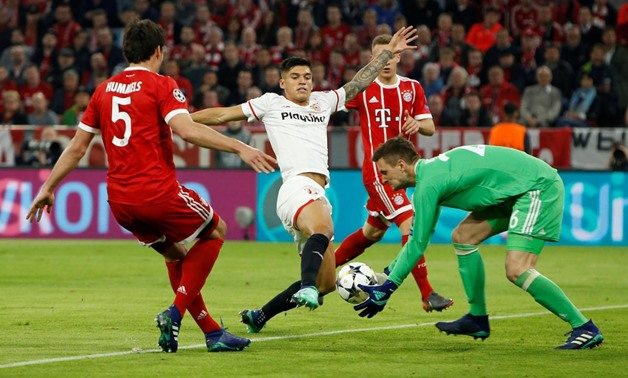 Soccer-Bayern push past Sevilla into Champions League last ...