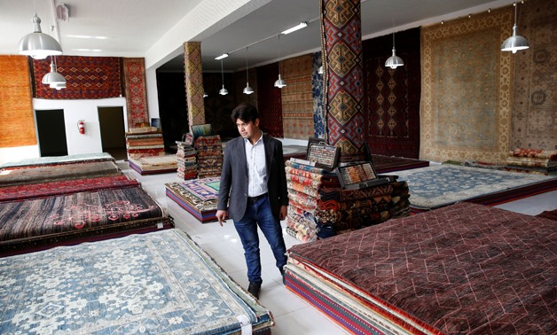 A vendor walks at the Afghanistan Rug and Carpet Center show room in Kabul, Afghanistan April 1, 2018. Picture taken April 1, 2018. REUTERS/Mohammad Ismail