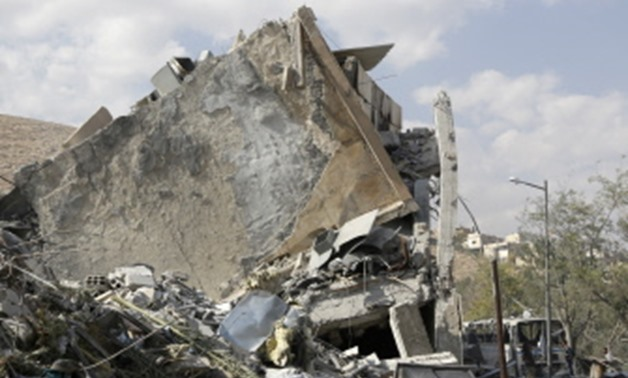 This picture taken on April 14, 2018 shows the wreckage of a building described as part of the Scientific Studies and Research Centre compound in the Barzeh district, north of Damascus, during a press tour organised by the Syrian information ministry. The