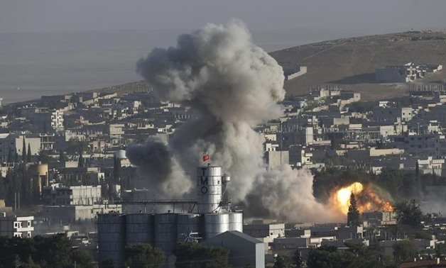 FILE: Smoke rises after a U.S.-led air strike in the Syrian town of Kobani Ocotber 10, 2014. Reuters
