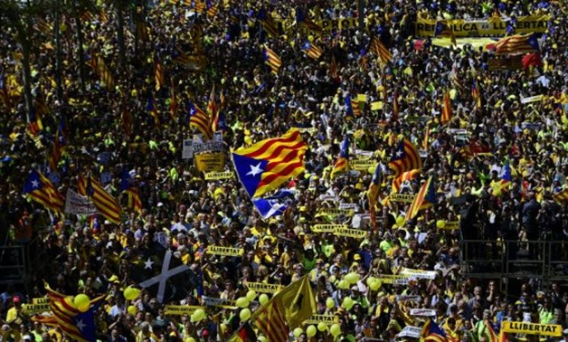 © Lluis Gene, AFP | Thousands of people marched in Barcelona on April 15, 2018 to protest the jailing of nine Catalan separatist leaders facing trial on 'rebellion' charges