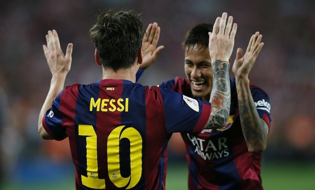 Lionel Messi celebrates with Neymar after scoring the first goal for Barcelona during the Spanish King's Cup Final between Athletic Bilbao and FC Barcelona at Nou Camp, Barcelona, Spain, May 30, 2015. — Reuters