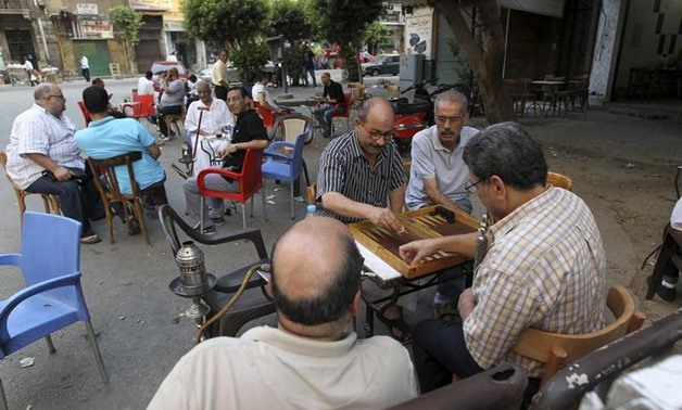 Men play backgammon at a cafe in Cairo August 18, 2013. REUTERS/Muhammad Hamed