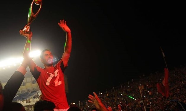 Retired footballer Mohamed Aboutrika celebrates his last African title with Al Ahly, CAF official account on twitter