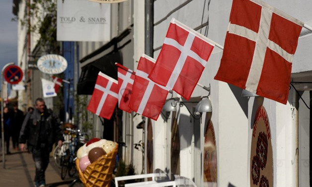 FILE PHOTO: Danish flags are pictured outside a cafe at the famous landmark Nyhavn in Copenhagen, Denmark April 18, 2017. REUTERS/Fabian Bimmer/File Photo
