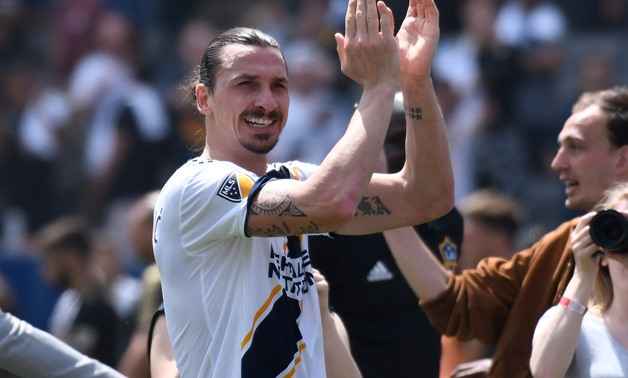 Carson, CA, USA; Los Angeles Galaxy forward Zlatan Ibrahimovic (9) claps after leading the Galaxy to a 4-3 win over Los Angeles FC at StubHub Center. Mandatory Credit: Robert Hanashiro-USA TODAY Sports