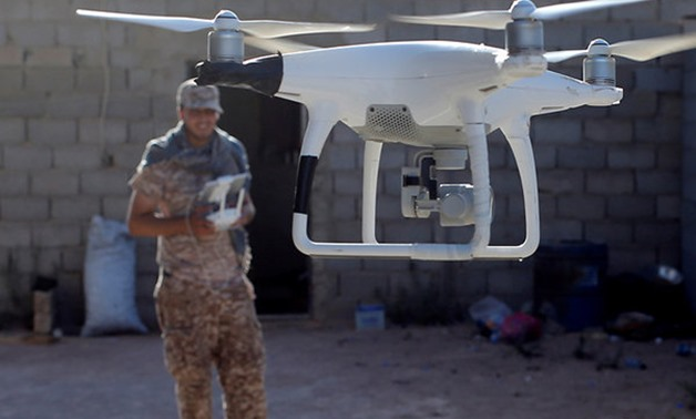 A fighter of Libyan forces allied with the U.N.-backed government uses a drone to observe Islamic State fighters positions in Sirte, Libya in 2016. (Reuters- File Photo)