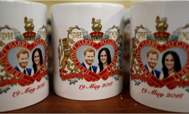 Mugs commemorating the wedding of Britain's Prince Harry and Meghan Markle are seen at the Prince William Pottery Company in Liverpool, Britain April 23, 2018. Picture taken April 23, 2018. REUTERS/Phil Noble