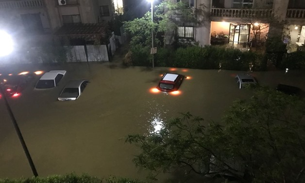 Vehicles submerged in the flooded New Cairo streets in which water levels rose over one meter after torrential rain hit hard several parts of Cairo and Giza on Tuesday, April 25, 2018 – Egypt Today
