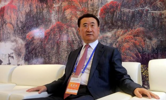 FILE PHOTO: Wang Jianlin, chairman of Chinese property developer Dalian Wanda Group, sits in a meeting room as he arrives for the launch ceremony of the Qingdao Oriental Movie Metropolis on the outskirts of Qingdao, Shandong province, September 22, 2013.
