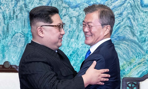 South Korean President Moon Jae-in and North Korean leader Kim Jong Un embrace at the truce village of Panmunjom