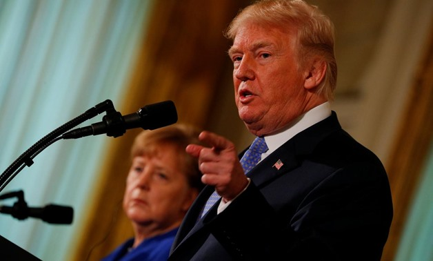U.S. President Donald Trump and Germany's Chancellor Angela Merkel hold a joint news conference in the East Room of the White House in Washington, U.S., April 27, 2018. REUTERS/Brian Snyder