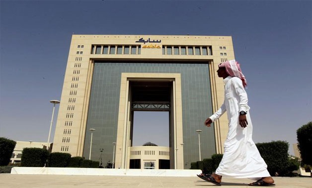 A man walks past the headquarters of Saudi Basic Industries Corp (SABIC) in Riyadh, Saudi Arabia October 27, 2013. REUTERS/Faisal Al Nasser/File Photo