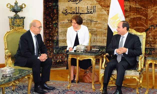 FILE - President Abdel Fatah al-Sisi (R) meets with French Foreign Minister Jean-Yves Le Drian (L) – June, 2017