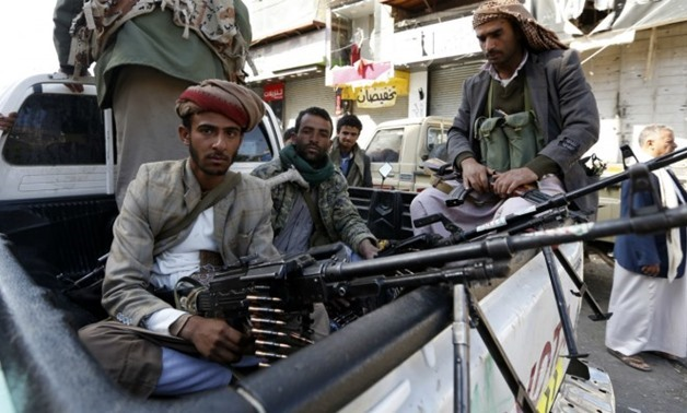Houthi rebels in front of the residence of former president Ali Abdullah Saleh in Sanaa - AFP