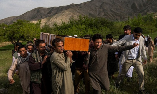 Relatives and friends of late AFP photographer Shah Marai carry his coffin at his burial outside Kabul