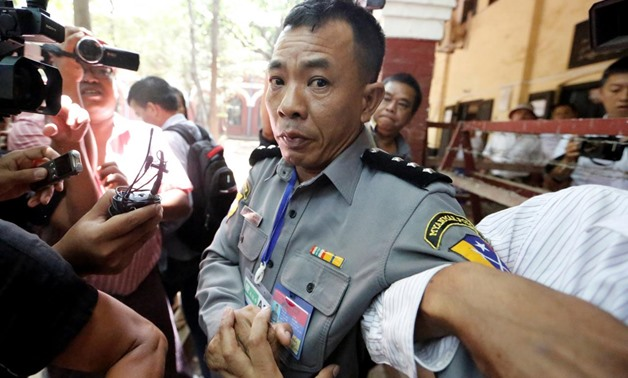 Prosecution witness police captain Moe Yan Naing walks outside the court room during a hearing of detained Reuters journalists Wa Lone and Kyaw Soe Oo in Yangon, Myanmar April 20, 2018 . REUTERS/Ann Wang