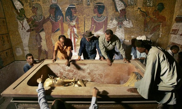 Zahi Hawass (back, 3rd L), head of the High Council for Antiquities, supervises the removal of the mummy of King Tutankhamen from his stone sarcophagus in his underground tomb in the Valley of the Kings in Luxor in this November 4, 2007 file photo. REUTER