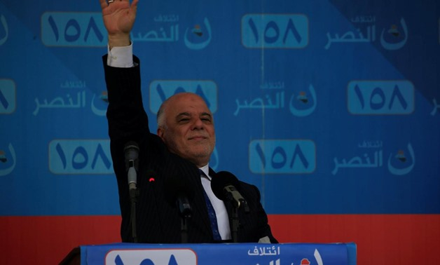 Iraqi Prime Minister Haidar al-Abadi greets his supporters during an election campaign rally in Najaf, Iraq May 3, 2018 - REUTERS/Alaa al-Marjani