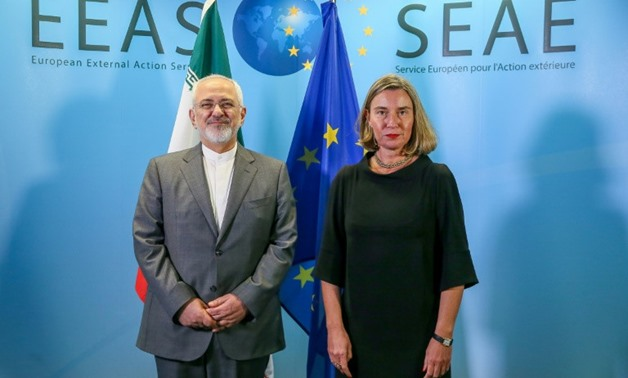 Foreign Minister of Iran Mohammad Javad Zarif (L) is welcomed by European Union Foreign Policy Chief Federica Mogherini in Brussels last month