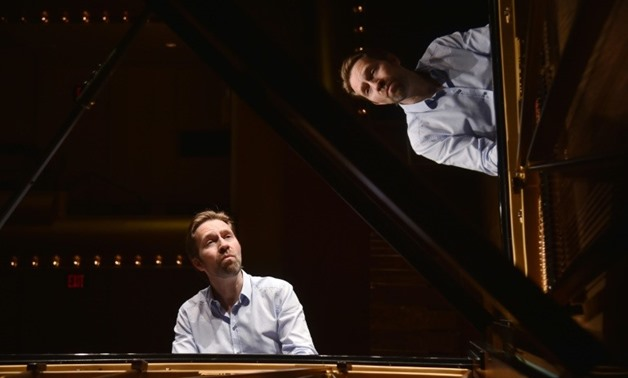 Norwegian virtuoso Leif Ove Andsnes, seen here at the piano in Lincoln Center's David Geffen Hall May 2, 2018, tackles Chopin's famous Ballades in his latest CD-AFP / HECTOR RETAMAL