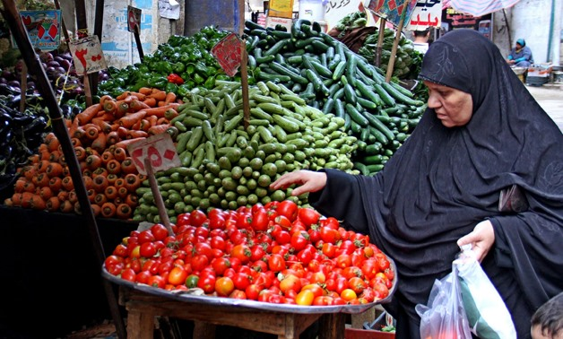 FILE- A woman buys vegetables in a market in Egypt- Egypt Today- Hussein Talall