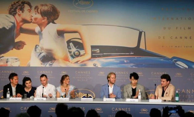 "71st Cannes Film Festival – News conference for the film ""Summer"" (Leto) in competition – Cannes, France May 10, 2018. Director of photography Vladislav Opeliants, cast members Roma Zver, Irina Starshenbaum, director Kirill Serebrennikov's empty seat, Teo"