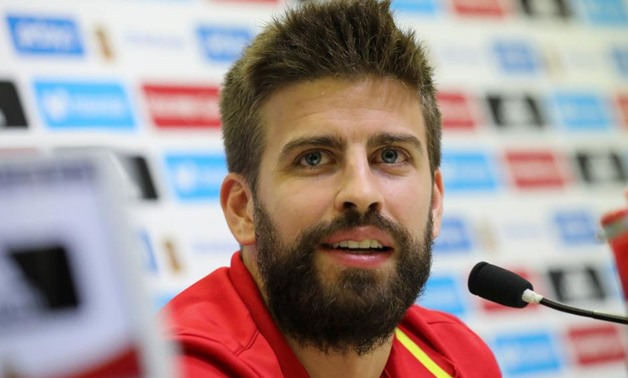 FILE PHOTO - Spain's national soccer team player Gerard Pique smiles during a news conference at the training grounds in Las Rozas, outside Madrid, Spain October 4, 2017. REUTERS/Sergio Perez